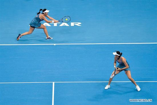 Latisha Chan (L) and Hao-Ching Chan of Chinese Taipei compete during the doubles final against Demi Schuurs of the Nederlands and Anna-Lena Groenefeld of Germany at the 2019 WTA Qatar Open in Doha, Qatar, Feb. 16, 2019. (Xinhua/Nikku)