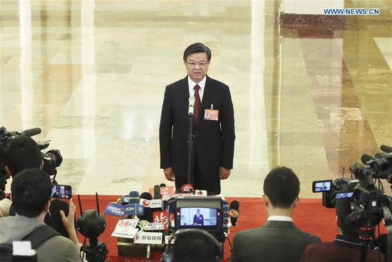 Ni Yuefeng, head of the General Administration of Customs, receives an interview after the opening meeting of the second session of the 13th National People's Congress at the Great Hall of the People in Beijing, capital of China, March 5, 2019. (Xinhua/Yin Gang)