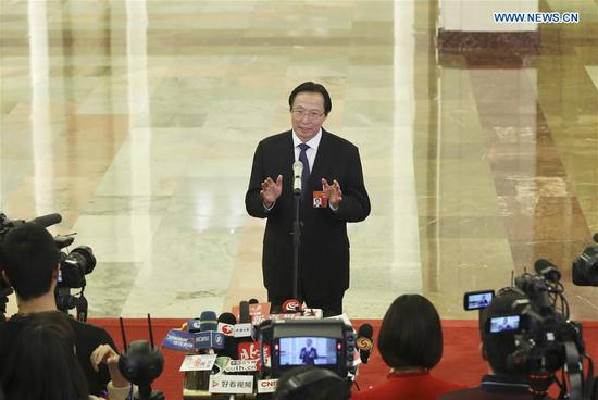 Minister of Agriculture and Rural Affairs Han Changfu receives an interview after the opening meeting of the second session of the 13th National People's Congress at the Great Hall of the People in Beijing, capital of China, March 5, 2019. (Xinhua/Yin Gang)