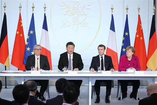Chinese President Xi Jinping (2nd L), French President Emmanuel Macron (2nd R), German Chancellor Angela Merkel (1st R) and European Commission President Jean-Claude Juncker attend the closing ceremony of a global governance forum co-hosted by China and France in Paris, France, March 26, 2019. (Xinhua/Ju Peng)