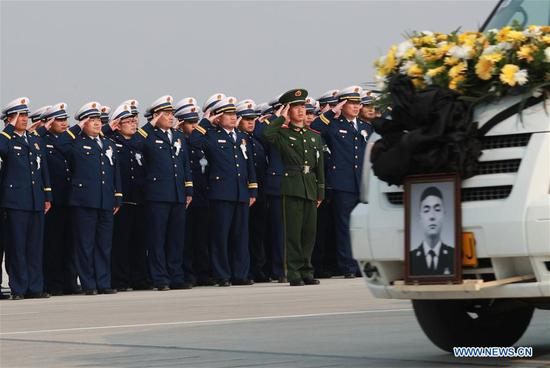 The remains of Xu Penglong, Zhao Yongyi, Zhang Shuai and Kang Rongzhen, martyrs who died while fighting a forest fire in southwest China's Sichuan Province, are taken back to their hometown in Linyi, east China's Shandong Province, April 5, 2019. (Xinhua/Zhu Wutao)