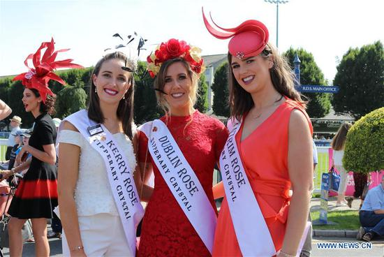 Contestants pose for photos at Ladies' Day in Dublin, Ireland, Aug. 8, 2019. Ladies' Day is a fashion competition held annually during Dublin Horse Show in the Irish capital. (Xinhua)