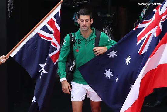 Novak Djokovic of Serbia enters the court before the men's singles final against Dominic Thiem of Austria at 2020 Australian Open in Melbourne, Australia on Feb. 2, 2020. (Xinhua/Bai Xuefei)