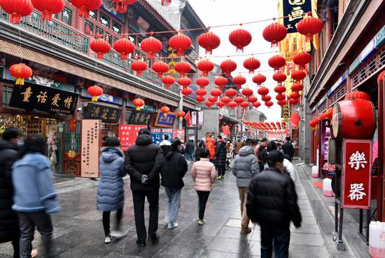 People visit an ancient cultural street in Tianjin, north China, Feb. 13, 2021, the second day of the Chinese Lunar New Year. (Xinhua/Zhao Zishuo)