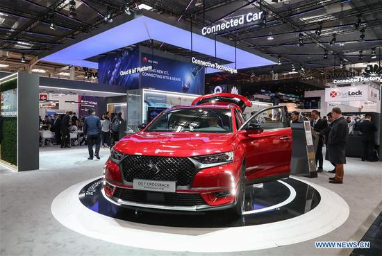 "A DS 7 Crossback vehicle of Groupe PSA, using ""Connected Vehicle Modula Platform"" and equipped with Huawei technology for new connected services, is on display at the booth of Huawei at Hanover Fair 2018 in Hanover, Germany. Around 1,300 Chinese exhibitors participate in Hanover Fair this year. (Xinhua/Shan Yuqi)"