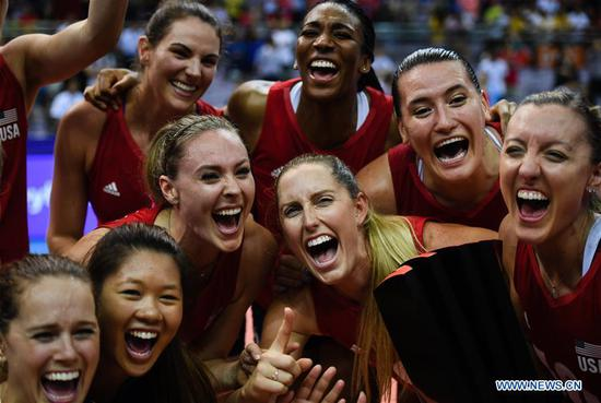 Players of the United States celebrate after winning the final match between Turkey and the United States at the 2018 FIVB Volleyball Nations League Women's Finals in Nanjing, capital of east China's Jiangsu Province, July 1, 2018. US won 3-2 and claimed the title of the event.(Xinhua/Li Xiang)