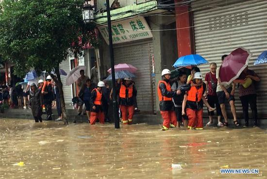Rescuers evacuate residents as heavy rain hits Bikou Township in Wenxian County, northwest China's Gansu Province, July 11, 2018. Many low-lying areas were inundated and traffic was disrupted in Wenxian county and neighboring areas. (Xinhua/Tian Chen)