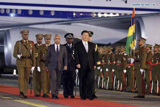 hinese President Xi Jinping (C) inspects the guard of honor during a welcoming ceremony held by Mauritian Prime Minister Pravind Jugnauth at the airport in Port Louis July 27, 2018. Xi arrived in Port Louis on Friday for a friendly visit to Mauritius. (Xinhua/Ding Lin)