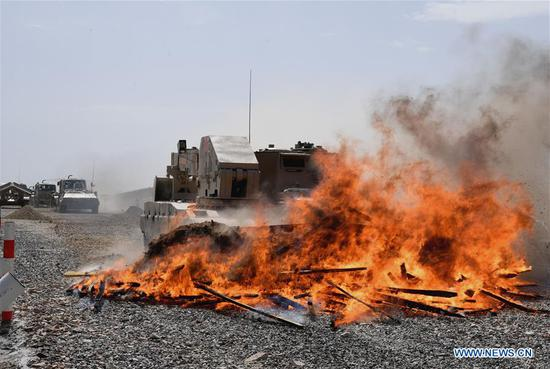 A vehicle operated by a Chinese crew cleans up the fire barrier during a match of the International Army Games 2018 in Korla, northwest China's Xinjiang Uygur Autonomous Region, Aug. 8, 2018. Three contests of the International Army Games 2018 in northwest China's Xinjiang Uygur Autonomous Region ended here Wednesday. (Xinhua/Zhang Yongjin)