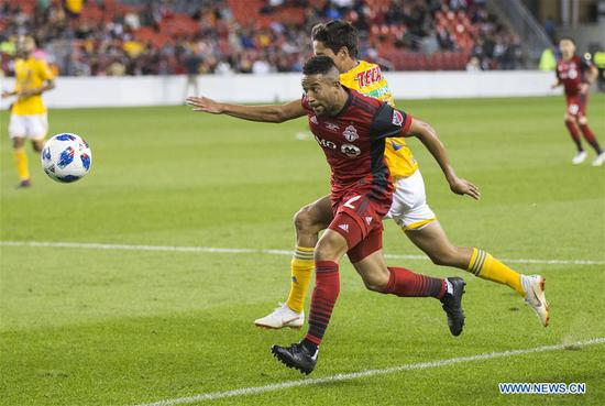 Justin Morrow (Front) of Canada's Toronto FC vies with Jurgen Damm of Mexico's Tigres UANL during the inaugural Campeones Cup match between Canada's Toronto FC and Mexico's Tigres UANL at BMO Field in Toronto, Canada, Sept. 19, 2018. Mexico's Tigres UANL won 3-1 and claimed the title. The Campeones Cup, established in 2018, is an annual North American soccer competition contested between the champions of the previous Major League Soccer season and the winner from Liga MX. (Xinhua/Zou Zheng)