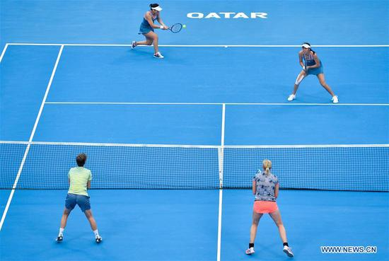 Hao-Ching Chan (R top) and Latisha Chan (L top) of Chinese Taipei compete with Demi Schuurs (L bottom) of the Nederlands and Anna-Lena Groenefeld of Germany during their doubles final at the 2019 WTA Qatar Open in Doha, Qatar, Feb. 16, 2019. Hao-Ching Chan and Latisha Chan won 2-1 and claimed the title. (Xinhua/Nikku)