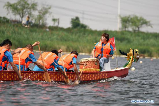 People take part in a dragon boat race to celebrate the Dragon Boat Festival in Shengfang Township, Bazhou City, north China's Hebei Province, June 7, 2019. Various activities are held to celebrate the Dragon Boat Festival, or Duanwu, which falls on June 7 this year. (Xinhua/Xu Wei)