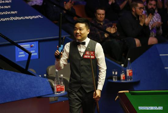 Ding Junhui of China reacts after winning the first round match against his compatriot Xiao Guodong at the World Snooker Championship 2018 at the Crucible Theatre in Sheffield, Britain on April 24, 2018. (Xinhua/Craig Brough)