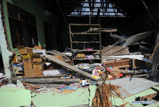 Photo taken on Aug. 8, 2018 shows a collapse elementary school after earthquake in North Lombok, West Nusa Tenggara, Indonesia, Aug. 8, 2018. The death toll of Indonesia's 7.0-magnitude earthquake rose significantly to 347 on Wednesday, spokesman of the national disaster management agency Sutopo Purwo Nugroho said. (Xinhua/Agung Kuncahya B.)