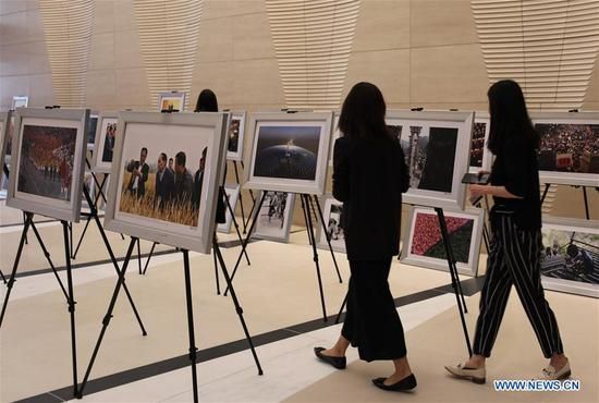 People visit the photo exhibition