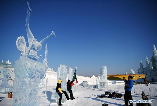 Contestants pose with ice sculptures at the 33rd Harbin international ice sculpture contest in Harbin, northeast China's Heilongjiang Province, Jan. 8, 2019. The contest concluded on Tuesday. (Xinhua/Wang Jianwei)