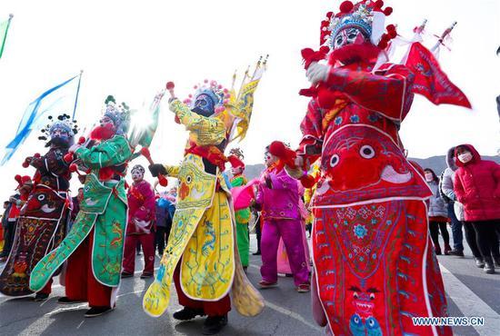Performers present folk opera during shehuo, a folk art festivity practiced during the Spring Festival, in Xindun Town of Ganzhou District in Zhangye, northwest China's Gansu Province, Feb. 13, 2019. (Xinhua/Wang Jiang)