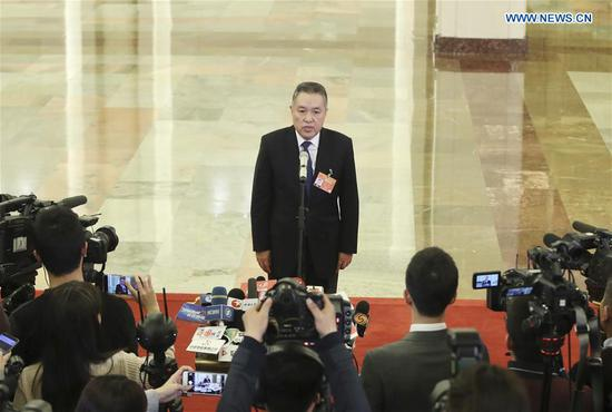 Zhang Mao, head of the State Administration for Market Regulation, receives an interview after the opening meeting of the second session of the 13th National People's Congress at the Great Hall of the People in Beijing, capital of China, March 5, 2019. (Xinhua/Yin Gang)