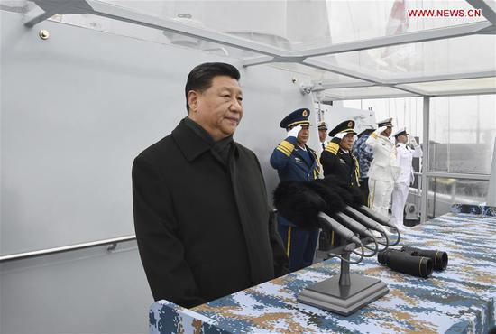 Chinese President Xi Jinping, also general secretary of the Communist Party of China Central Committee and chairman of the Central Military Commission, reviews a multinational fleet during a naval parade held in Qingdao, east China's Shandong Province, on April 23, 2019. A naval parade was staged here to mark the 70th founding anniversary of the Chinese People's Liberation Army Navy on Tuesday. (Xinhua/Li Gang)