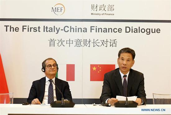 Chinese Finance Minister Liu Kun (R) and his Italian counterpart Giovanni Tria preside over the first Italy-China Finance Dialogue in Milan, Italy, July 10, 2019. (Xinhua/Alberto Lingria)