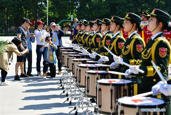 Journalists observe a training session of military band during a visit to the National Day military parade training site in Beijing, capital of China, Sept. 25, 2019. A total of 47 journalists from home and abroad on Wednesday visited a training site of the military parade for the upcoming National Day celebrations. (Xinhua/Wei Peiquan)