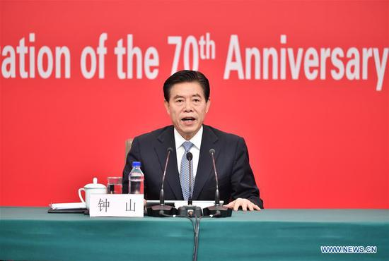 Chinese Minister of Commerce Zhong Shan speaks at a press conference in Beijing, capital of China, Sept. 29, 2019. The press center for the celebration of the 70th anniversary of the founding of the People's Republic of China held a press conference on Sunday on China's efforts to advance opening-up to a higher level and promote high-quality development of commerce. (Xinhua/Li Xin)