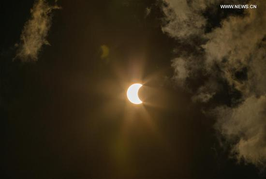 A partial solar eclipse is seen in Bangkok, Thailand, June 21, 2020. (Xinhua/Zhang Keren)