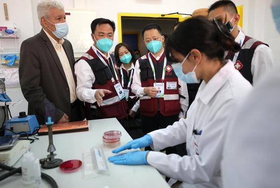Members of a Chinese medical team visit the Central Public Health Lab under the Palestinian Health Ministry in Ramallah, June 14, 2020. (Photo by Ayman Nobani/Xinhua)