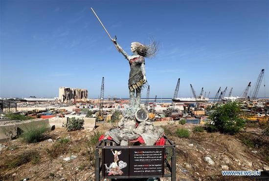 A statue of a lady is seen near the Beirut port in Lebanon, Oct. 20, 2020. Lebanese artists create a statue of a lady by using the rubbles of the Beirut port explosion, with a clock stopping at the moment of the explosion at about 6:08 p.m. on Aug. 4, 2020. (Xinhua/Bilal Jawich)