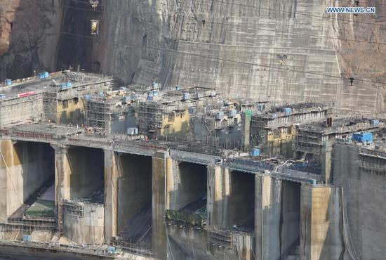 Workers are busy at the construction site of the Baihetan hydropower station in southwest China, April 27, 2021. Construction of the Baihetan hydropower station in southwest China is proceeding smoothly. With a total of 16 homegrown million-kilowatt generating units, Baihetan hydropower station, located on the Jinsha River, the upper section of the Yangtze, straddling Yunnan and Sichuan provinces, is the second-largest in China after the Three Gorges Dam project in the central province of Hubei in terms of installed capacity. (Photo by Liang Zhiqiang/Xinhua)