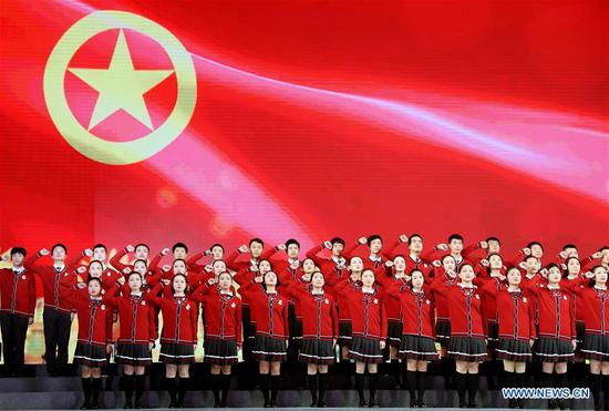 Students from Songjiang No. 2 Middle School perform during a chorus event in Shanghai, east China, April 29, 2019. A chorus event was held on April 29, 2019 in Shanghai to commemorate the centenary of May Fourth Movement. Some 6,000 youths from local schools attended the event. (Xinhua/Liu Ying)