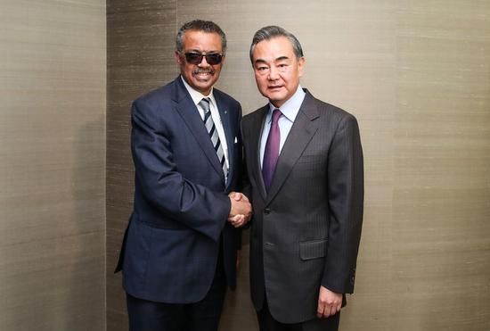 Chinese State Councilor and Foreign Minister Wang Yi (R) meets with the World Health Organization Director-General Tedros Adhanom Ghebreyesus on the sidelines of the Munich Security Conference, in Munich, Germany, Feb. 15, 2020. (Xinhua/Shan Yuqi)