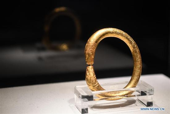 A gold-plated ring found on the wreckage of Nanhai No. 1 is displayed at the Maritime Silk Road Museum on Hailing Island of Yangjiang, south China's Guangdong Province, May 12, 2020. The excavation of the Nanhai No. 1, a shipwreck dating back to the Song Dynasty (960 A.D.-1279 A.D.), was listed by China in its top 10 archaeological discoveries for 2019. More than 180,000 relics including porcelain products, gold, silver, copper and iron relics and coins have been found from this ancient merchant ship. (Xinhua/Deng Hua)