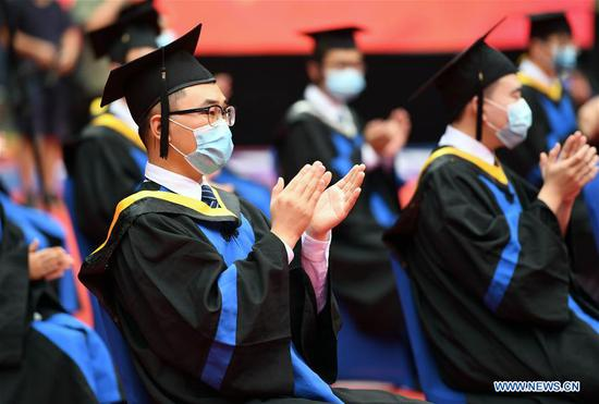 Graduates attend the commencement ceremony at Beihang University in Beijing, capital of China, June 29, 2020. Beihang University held a commencement ceremony for the Class of 2020 (Bachelor's Degrees) on Monday. In order to reduce the risk of infection of COVID-19, only a minority of graduates attended the ceremony on site with the others attending online. (Xinhua/Ren Chao)