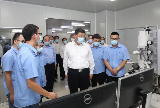 Chinese President Xi Jinping, also general secretary of the Communist Party of China Central Committee and chairman of the Central Military Commission, visits Chaozhou Three-Circle (Group) Co., Ltd. to learn about the company's indigenous innovation, production and operation in Chaozhou, south China's Guangdong Province, Oct. 12, 2020. Xi on Monday arrived in Guangdong to begin an inspection tour of the province. (Xinhua/Wang Ye)
