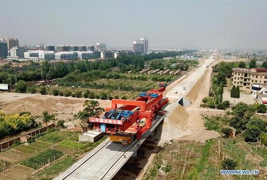 Workers work at a construction site of the Beijing-Zhangjiakou high-speed railway in Zhangjiakou, north China's Hebei Province, June 11, 2018. The railway, connecting China's capital Beijing and Zhangjiakou of north China's Hebei Province, is designed at a speed of 350 kilometers per hour and is expected to be put into use at the end of 2019. (Xinhua/Yang Shiyao)