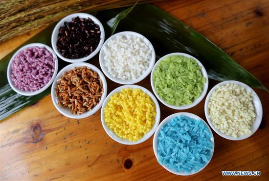 Photo taken on June 12, 2018 shows materials for making colorful Zongzi, pyramid-shaped dumplings made of glutinous rice wrapped in bamboo or reed leaves, to greet the upcoming Dragon Boat Festival in Rong'an County, south China's Guangxi Zhuang Autonomous Region. (Xinhua/Tan Qinghe)