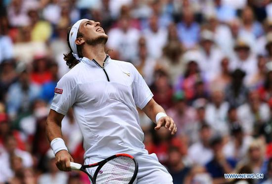 Lukas Lacko of Slovakia reacts during the men's singles second round match against Roger Federer of Switzerland at the Wimbledon Tennis Championships in London, Britain on July 4, 2018. Federer won 3-0. (Xinhua/Guo Qiuda)