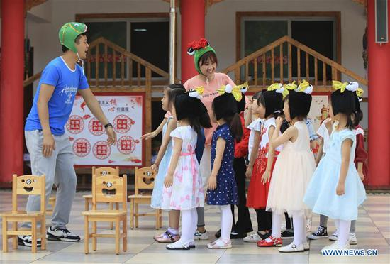 Children rehearse for Children's Day performance with their teachers at a kindergarten in Zhangjiajie City, central China's Hunan Province, May 27, 2019. (Xinhua/Wu Yongbing)