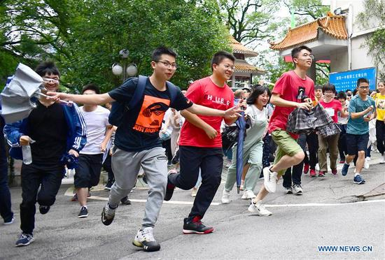 Examinees leave the exam venue at the No. 1 Middle School in Liuyang City, central China's Hunan Province, June 7, 2019. China's national college entrance examination, or Gaokao, started Friday this year. (Xinhua/Peng Hongxia)