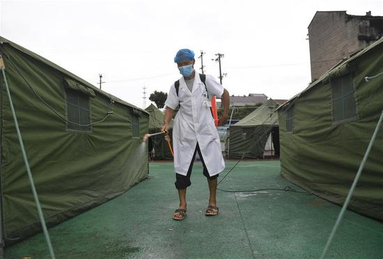 An epidemic prevention worker disinfects a make-shift shelter in QuananTown of Neijiang City, southwest China's Sichuan Province, Sept. 8, 2019. The 5.4-magnitude earthquake in Sichuan Province had killed one person and left 63 others injured, three severely, as of 6 p.m. Sunday, local authorities said. (Xinhua/Liu Kun)