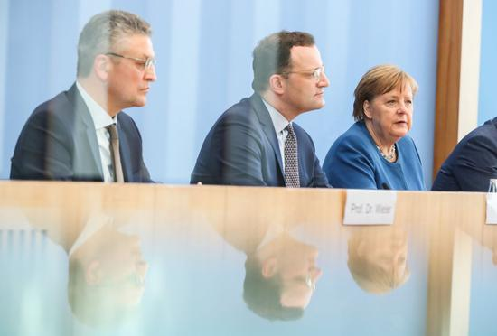 German Chancellor Angela Merkel (R), German Health Minister Jens Spahn (C) and Robert Koch Institute (RKI) President Lothar Wieler attend a press conference of COVID-19 situation in Germany, in Berlin, capital of Germany, March 11, 2020. (Xinhua/Shan Yuqi)