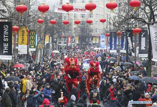 People take part in the 2019 Spring Festival parade in downtown Antwerp, Belgium, on Feb. 2, 2019. A long parade was held in the Belgian city of Antwerp on Saturday as part of the 2019 Spring Festival organized by the local Chinese community and Antwerp to mark the beginning of the Chinese New Year. (Xinhua/Ye Pingfan)