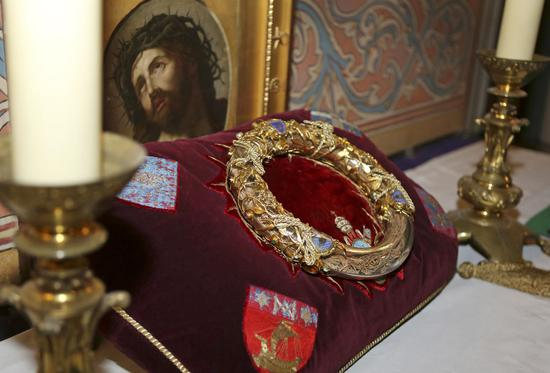 The Crown of Thorns believed to have been worn by Jesus Christ and bought by King Louis IX in 1239, seen here on March 21, 2014, was presented to Notre Dame Cathedral in Paris. It survived the colossal fire that swept through the famed cathedral on April 15. The fire led to significant damage to the roof and interior of the building, and caused the collapse of a spire. [Photo: IC]