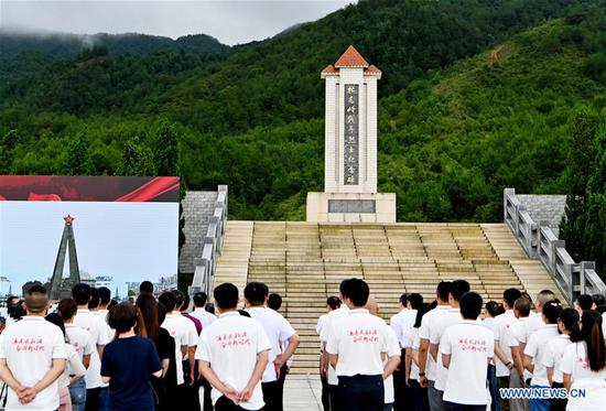 The launching ceremony of an activity that will take journalists to retrace the route of the Long March is held in Changting County in Longyan City, southeast China's Fujian Province, June 11, 2019. The activity is aimed at paying tribute to the revolutionary martyrs and passing on the traditions of revolution, as the country celebrates the 70th anniversary of the founding of the People's Republic of China this year. Over 500 journalists from more than 30 media outlets across the country attended the ceremonies. The Long March was a military maneuver carried out by the Chinese Workers' and Peasants' Red Army from 1934 to 1936. During this period, they left their bases and marched through rivers, mountains and arid grassland to break the siege of Kuomintang forces and continue to fight Japanese aggressors. Many marched as far as 12,500 km. (Xinhua/Wei Peiquan)