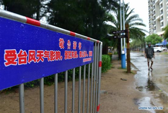 Photo taken on Aug. 25, 2019 shows a sign reading scenic area closed at Maluan Bay scenic spot in Dongshan County, southeast China's Fujian Province. Typhoon Bailu made landfall in southeast China's Fujian Province Sunday, local authorities said. With a maximum wind force of 90 km/h, Bailu, the 11th typhoon this year, made landfall in Dongshan County at 7:25 a.m. (Xinhua/Lin Shanchuan)
