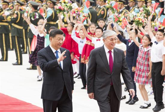Chinese President Xi Jinping holds a welcoming ceremony for visiting Kazakh President Kassym-Jomart Tokayev before their talks at the Great Hall of the People in Beijing, capital of China, Sept. 11, 2019. (Xinhua/Huang Jingwen)