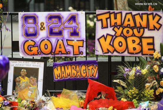 Photo taken on Jan. 29, 2020 shows the memorials near the Staples Center to pay respect to Kobe Bryant, in Los Angeles, California, the United States. Retired NBA star Kobe Bryant was one of nine people killed in a helicopter crash amid a foggy condition in the hills above Calabasas, southern California, on Jan. 26, 2020. (Xinhua/Li Ying)