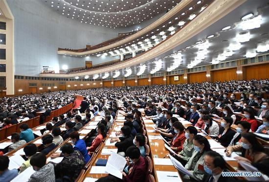 Members of the 13th National Committee of the Chinese People's Political Consultative Conference (CPPCC) attend the opening meeting of the third session of the 13th CPPCC National Committee at the Great Hall of the People in Beijing, capital of China, May 21, 2020. (Xinhua/Li Xueren)