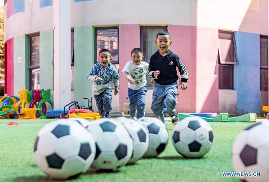 File photo taken on Aug. 22, 2019 shows children from the Experimental Kindergarten of Tibet Autonomous Region having a football training session in Lhasa. The Chinese government has, so far, spent more than 20 billion yuan on supporting the region's free education program, making education more accessible for nearly nine million students. Students across all grades can also access additional support through a number of projects and initiatives under 40 educational aid projects, providing grants and scholarships, among others. (Xinhua/Sun Fei)